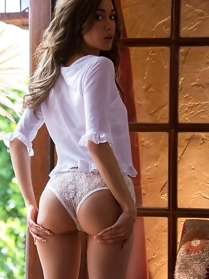 Mila Blaze pulls down her white panties
